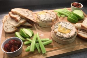 baked camembert with toast and celery