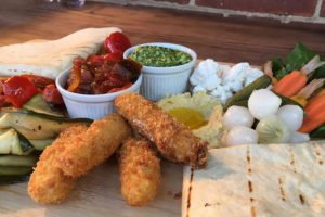 garden board with halloumi sticks and pitta bread